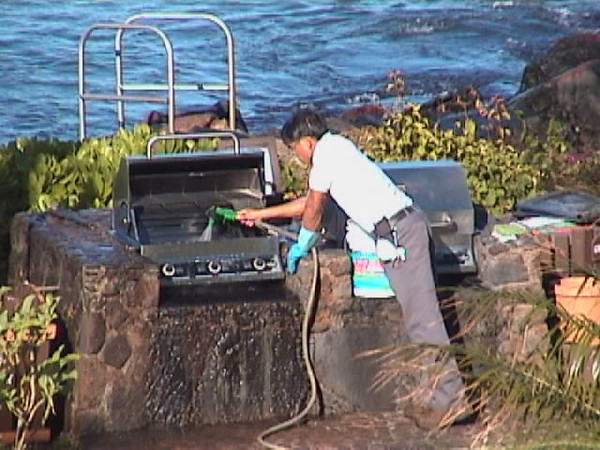 Guy cleaning grill.jpg
