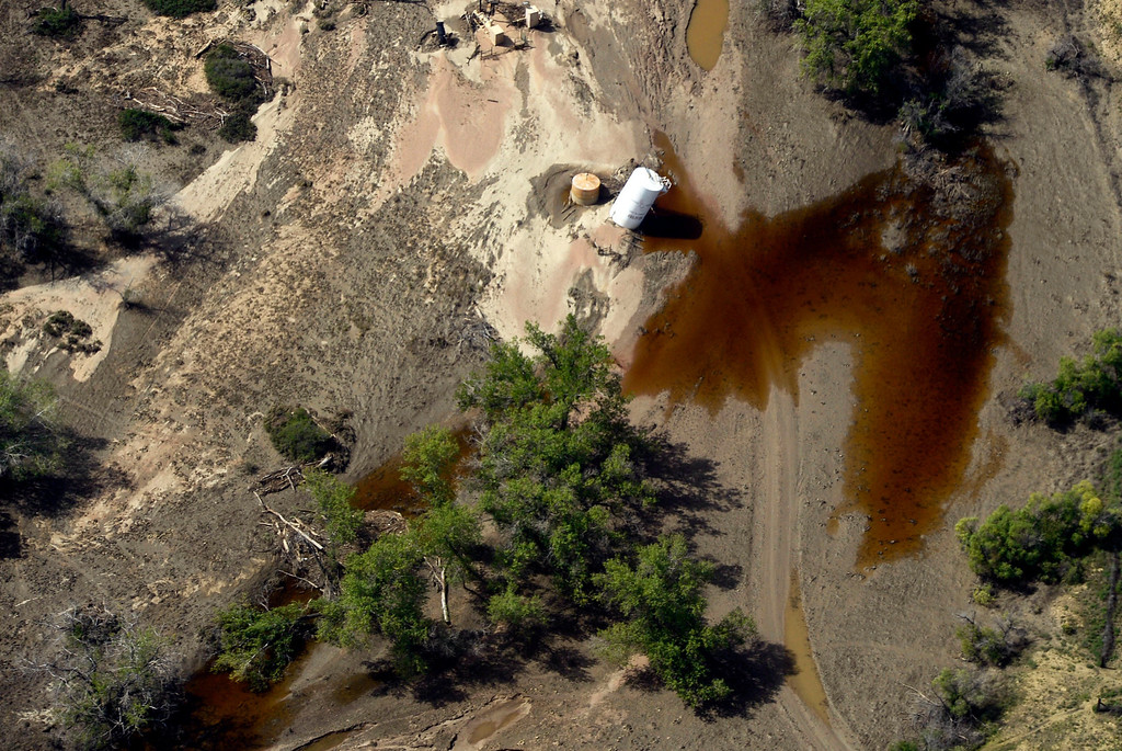 . WELD COUNTY, CO - SEPTEMBER 19: Liquid leaks from a tank south of Milliken Colorado Thursday morning, September 19, 2013 as flood waters are starting to recede from last weeks floods. (Photo By Andy Cross/The Denver Post)