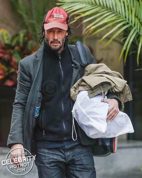 EXCLUSIVE: Keanu Reeves Carries His Own Luggage In A Plain Drawstring Bag, Canada