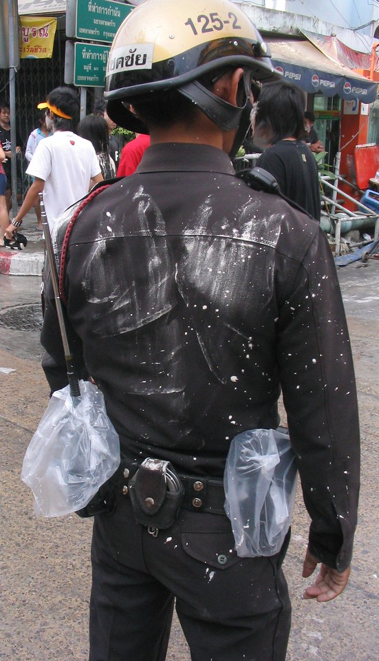 Even Police come out but protect their gear with plastic bags.