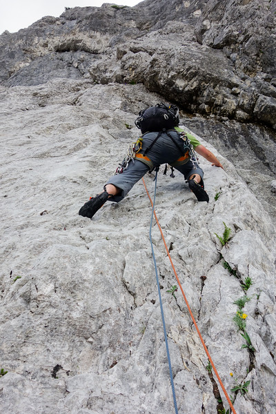 """Jesko climbs up the """"Bandunterbrechung"""" (band interruption, V-). Again he follows rusty pitons to the right, when the better way is to go left."""