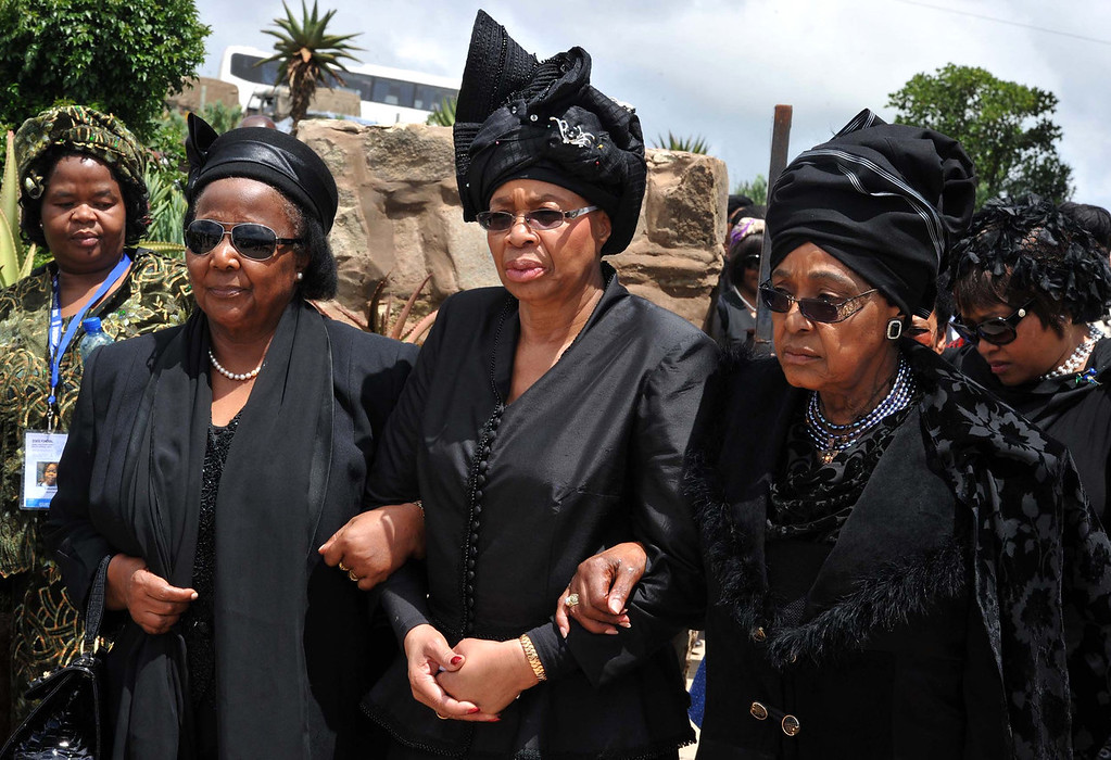 . Winnie Madikizela-Mandela, right, Nelson Mandela\'s former wife, and Nelson Mandelaís widow Graca Machel, centre, walk from the funeral service to the burial site of  former South African President Nelson Mandela in Qunu, South Africa, Sunday, Dec. 15, 2013.  (AP Photo/Elmond Jiyane, GCIS)