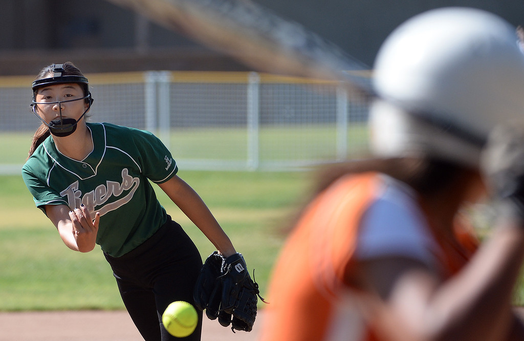 . Westridge starting pitcher Jackie Pai throws to the plate against Poly in the first inning of a prep softball game at Westridge High School in Pasadena, Ca on Tuesday, April 15, 2014. Poly won 11-1. (Keith Birmingham Pasadena Star-News)