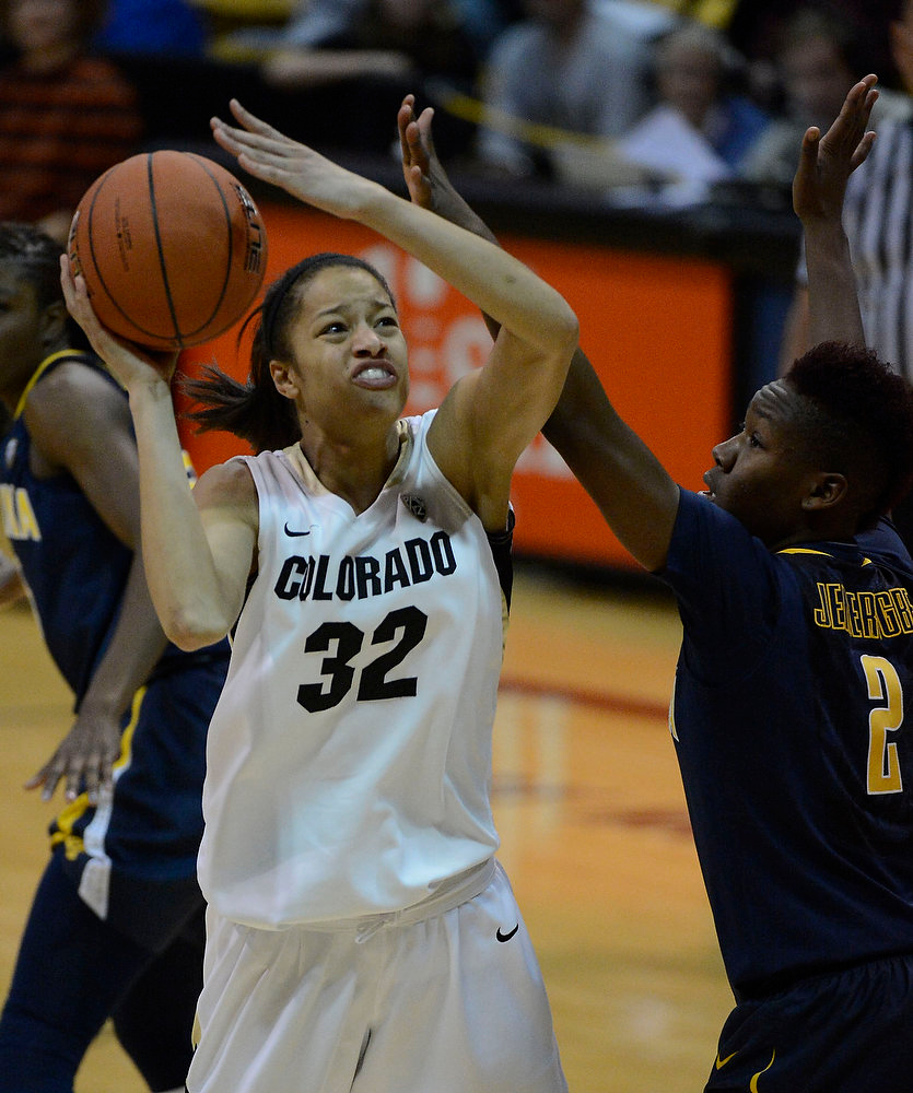 . Colorado Buffaloes forward Arielle Roberson (32) takes a shot on California Golden Bears guard Afure Jemerigbe (2) during the second half Sunday, January 6, 2013 at Coors Events Center. John Leyba, The Denver Post
