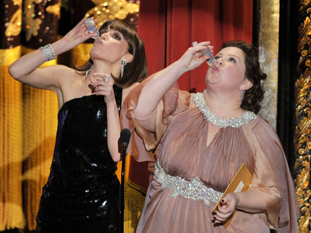 . Presenters Rose Byrne (L) and Melissa McCarthy speak onstage during the 84th Annual Academy Awards held at the Hollywood & Highland Center on February 26, 2012 in Hollywood, California.  (Photo by Kevin Winter/Getty Images)