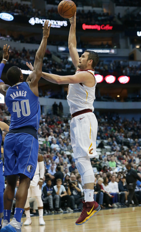 . Cleveland Cavaliers forward Kevin Love (0) shoots against Dallas Mavericks forward Harrison Barnes (40) during the first half of an NBA basketball game in Dallas, Saturday, Nov. 11, 2017. (AP Photo/LM Otero)