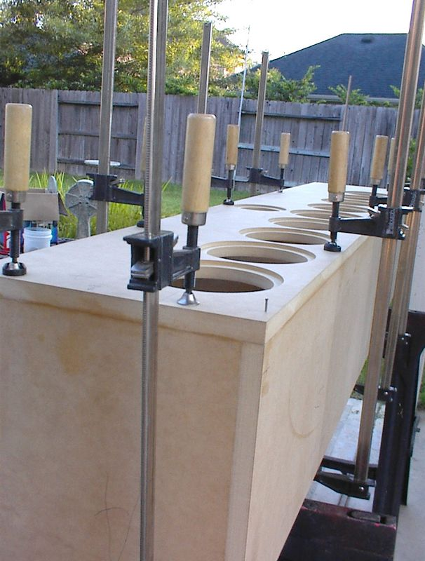 """Here's a useful enclosure construction  tip - First fit the front baffle to the box without glue and clamp into the exact position you want. Then drill a pilot hole at each corner and insert a #4 by 1-1/2"""" finishing nail into each pilot hole. Remove the clamps and nails, apply a bead of carpenters glue, and set the baffle onto the box. Push a nail into each pilot hole again to align the baffle exactly in place, then clamp all around. The finishing nails hold the baffle in position so it doesn't slide around when you tighten the clamps. This technique enbles you to avoid using screws, which leave holes to be filled with wood putty before painting, a labor intensive task."""