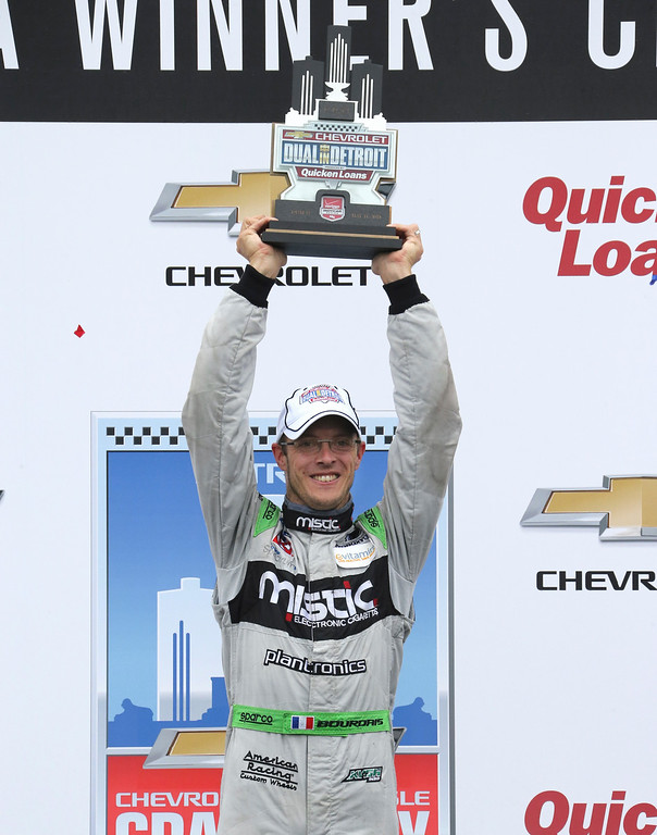 . Sebastien Bourdais, of France, celebrates winning the second race of the IndyCar Detroit Grand Prix auto racing doubleheader, Sunday, May 31, 2015, in Detroit. (AP Photo/Bob Brodbeck)