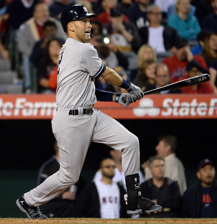 . New York Yankees\' Derek Jeter watches his single in the third inning of a baseball game against the Los Angeles Angels at Anaheim Stadium in Anaheim, Calif., on Tuesday, May 6, 2014.  (Keith Birmingham Pasadena Star-News)