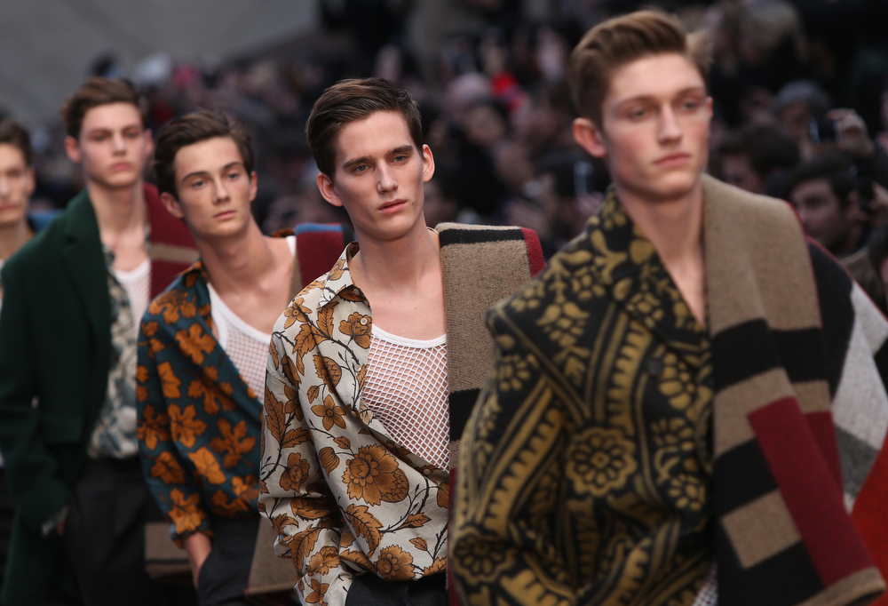 . Models wear designs created by Burberry Prorsum during London Collections for Men Autumn/Winter 2014 fashion show, at the Royal Albert Memorial in west London, Wednesday, Jan. 8, 2014. (Photo by Joel Ryan/Invision/AP)