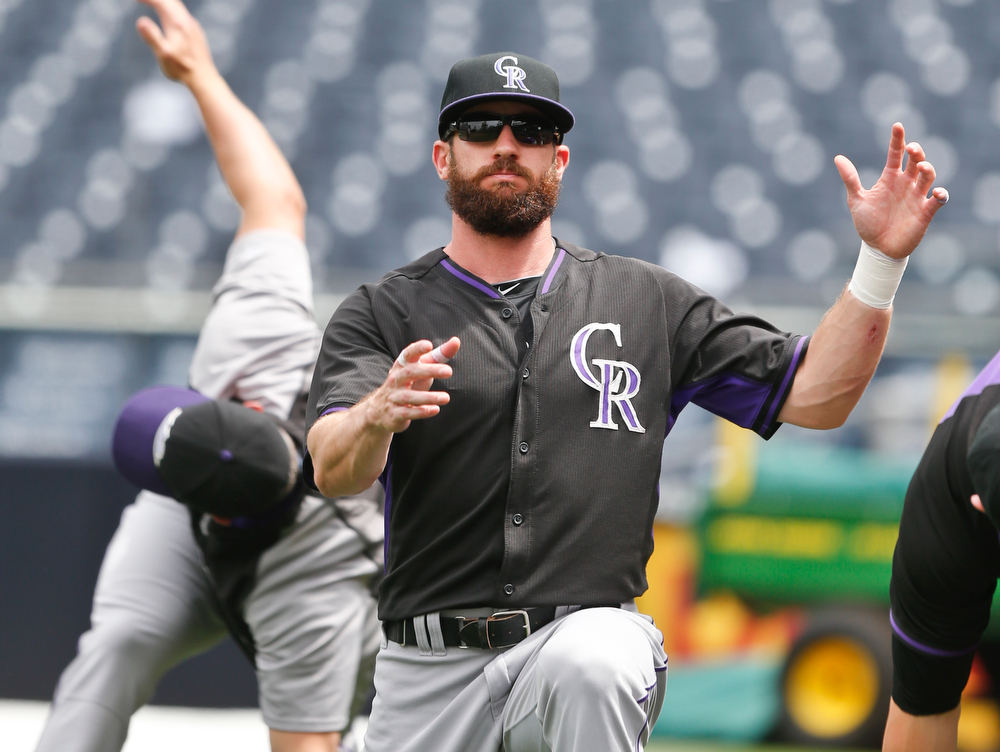 . Colorado Rockies right fielder Charlie Blackmon does his calisthenics prior to batting practice for the Rockies\' baseball game against the San Diego Padres on Thursday, April 17, 2014, in San Diego. (AP Photo/Lenny Ignelzi)