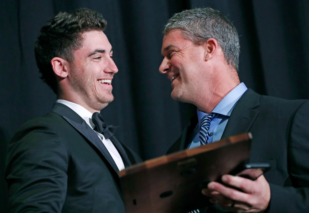 ". National League Rookie of the Year Cody Bellinger, left, of the Los Angeles Dodgers, receives his award from his father Clayton Daniel ""Clay\"" Bellinger during the New York Chapter of the Baseball Writers\' Association of America annual dinner in New York, Sunday, Jan. 28, 2018. (AP Photo/Kathy Willens)"