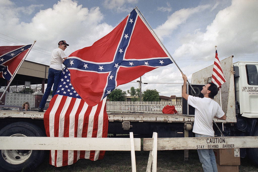 . Arkansas-based Knights of the Ku Klux Klan member Hank Pritchard, right, and a supporter set up an impromptu stage in Davie  Jan. 19, 1993 for Monday�s KKK rally. Pritchard organized the rally which was nearly scrubbed until he won a federal court ruling allowing the rally to proceed. (AP Photo/Kathy Willens)