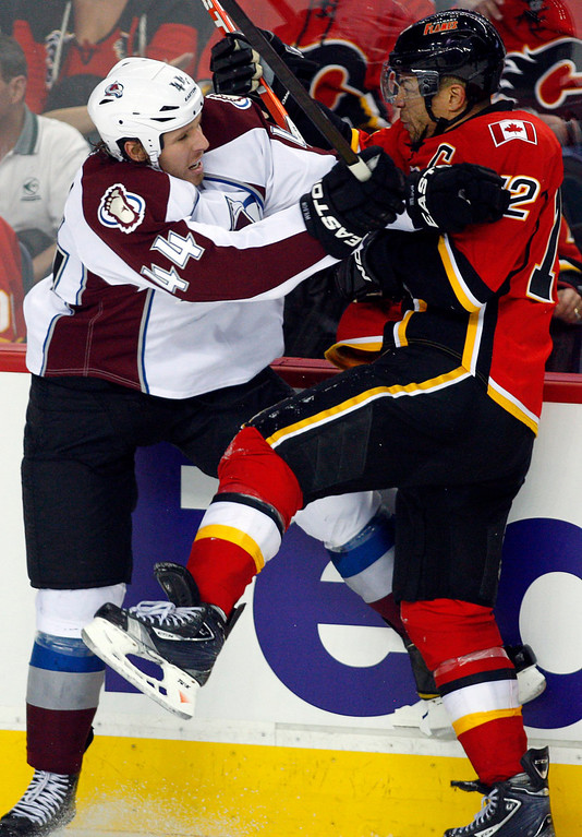 . Colorado Avalanche\'s Ryan Wilson, left, and Jarome Iginla collide during the second period of an NHL hockey game Thursday, Jan. 31, 2013, in Calgary, Alberta. (AP Photo/The Canadian Press, Jeff McIntosh)