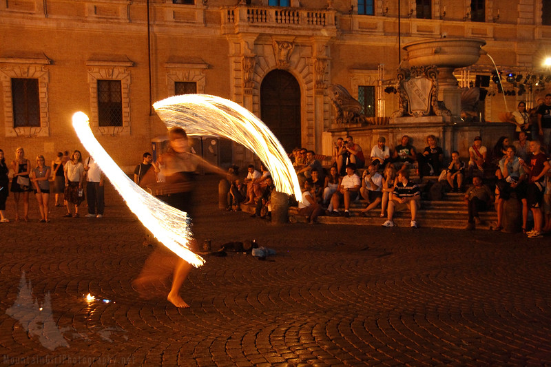 Street performer in square of Santa Maria in Trastevere.