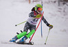 Lily Rezai hits a gate in the U16 Slalom race at Bosquet Ski Area on February 2, 2014.