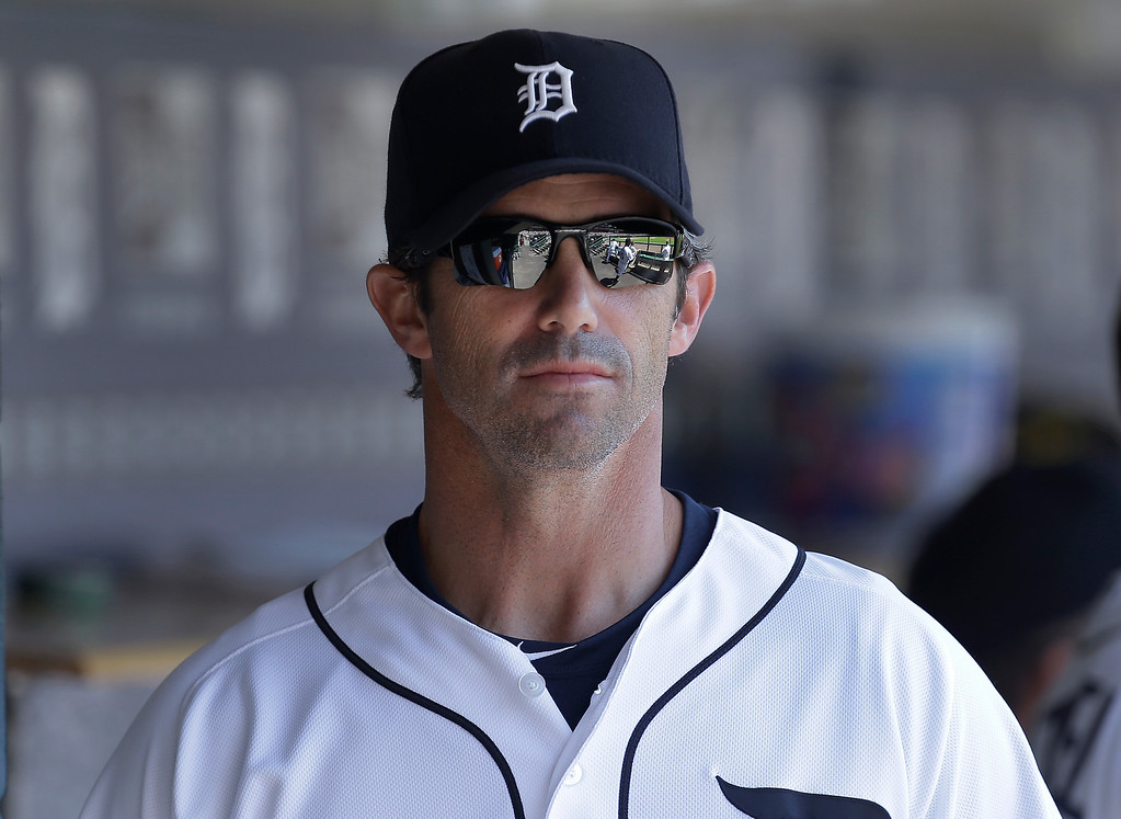 . Detroit Tigers manager Brad Ausmus watches from the dugout against the Toronto Blue Jays before the first inning of a baseball game in Detroit, Thursday, June 5, 2014. (AP Photo/Paul Sancya)