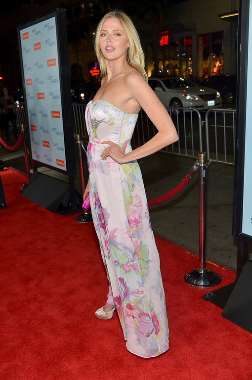 """. Actress Estella Warren arrives at the premiere of Relativity Media\'s \""""Safe Haven\"""" at TCL Chinese Theatre on February 5, 2013 in Hollywood, California.  (Photo by Alberto E. Rodriguez/Getty Images for Relativity Media)"""