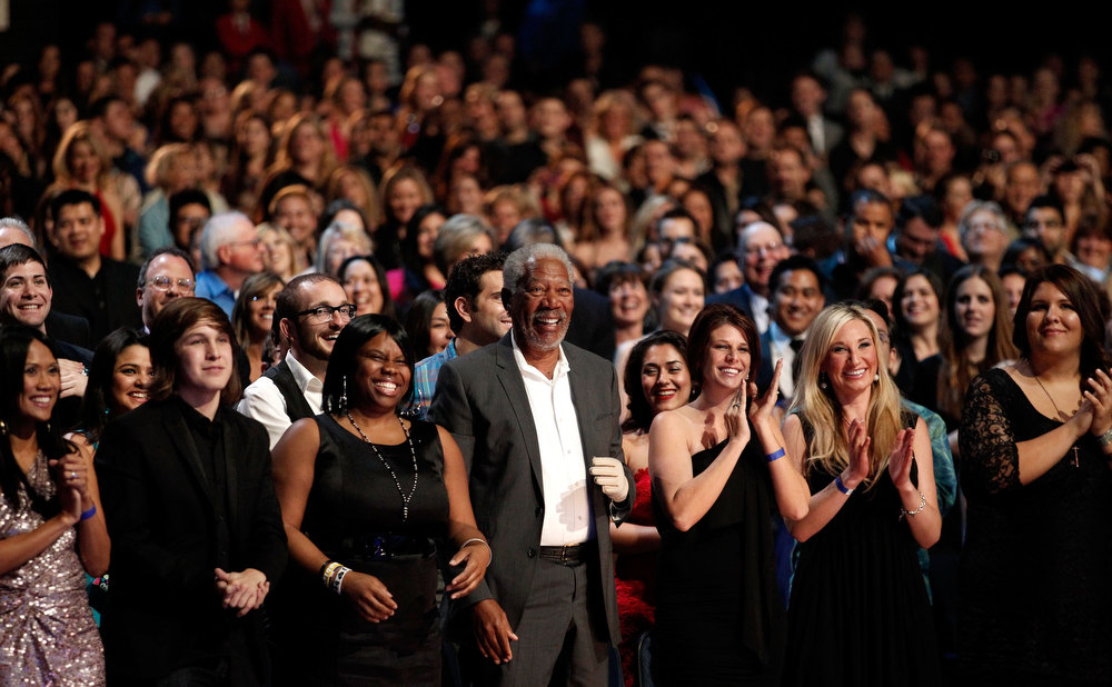 Description of . Actor Morgan Freeman (C) in the audience during the 2012 People's Choice Awards at Nokia Theatre L.A. Live on January 11, 2012 in Los Angeles, California. Morgan Freeman ranked as Google's eighth most searched trending person of 2012.  (Photo by Christopher Polk/Getty Images for PCA)