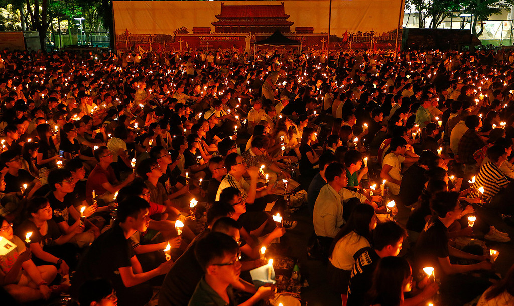 . Tens of thousands of people attend a candlelight vigil at Victoria Park in Hong Kong Wednesday June 4, 2014, to mark the 25th anniversary of the June 4th Chinese military crackdown on the pro-democracy movement in Beijing. (AP Photo/Kin Cheung)