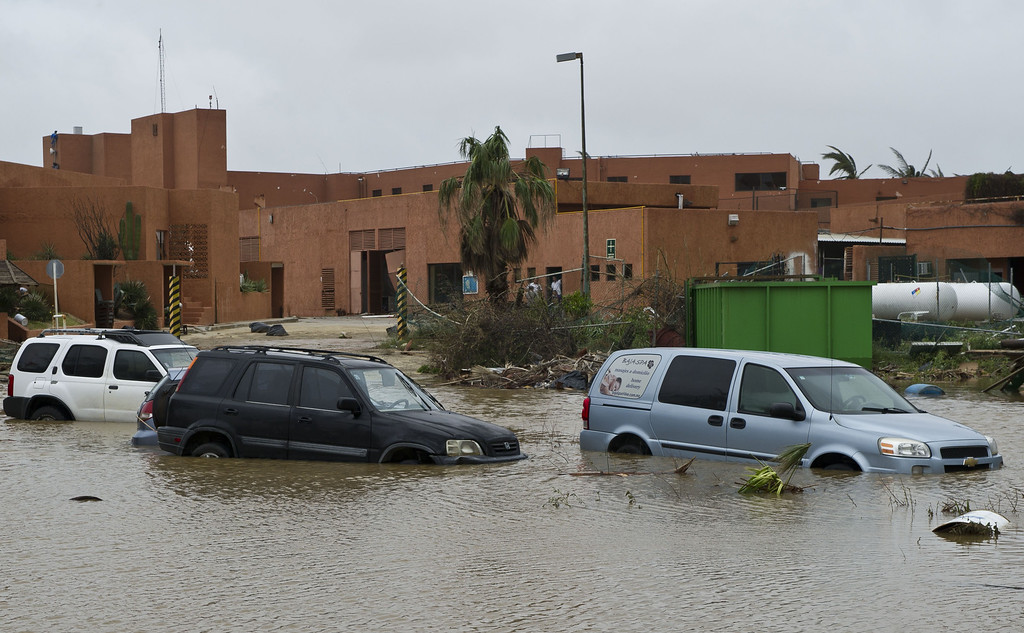 . View of cars stranded in a flooded street in San Jose del Cabo, on September 15, 2014 after hurricane Odile knocked down trees and power lines in Mexico\'s Baja California peninsula. AFP PHOTO/RONALDO SCHEMIDT/AFP/Getty Images