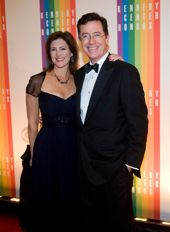 . Comedian Stephen Colbert and wife, Evelyn Colbert, arrive at the Kennedy Center for the Performing Arts for the 2012 Kennedy Center Honors Performance and Gala Sunday, Dec. 2, 2012 at the State Department in Washington. (AP Photo/Kevin Wolf)
