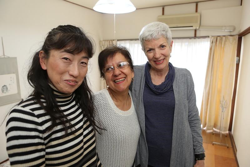 Miho san, Xinia san and Sarah san share a group embrace.