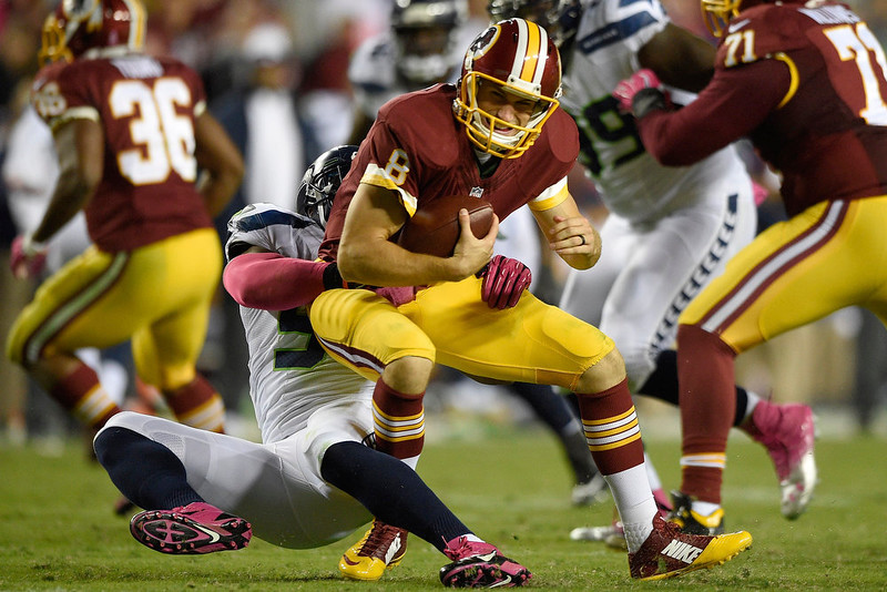 . Washington Redskins quarterback Kirk Cousins (8) is sacked by Seattle Seahawks middle linebacker Bobby Wagner (54) during the second half of an NFL football game in Landover, Md., Monday, Oct. 6, 2014. (AP Photo/Nick Wass)