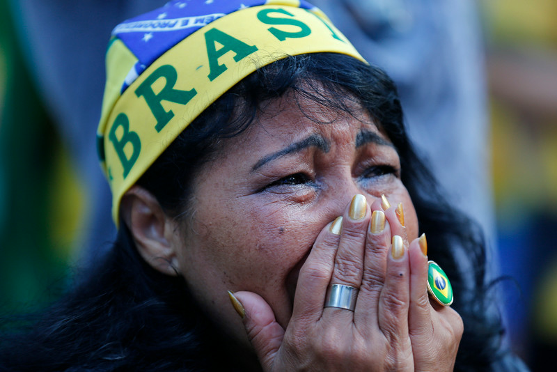 . A fan of Brazil reacts as she watches as the Netherlands scores a second goal against Brazil, during the match for the third place finish of the World Cup, at the FIFA Fan Fest in Sao Paulo, Brazil, Saturday, July 12, 2014. (AP Photo/Dario Lopez-Mills)