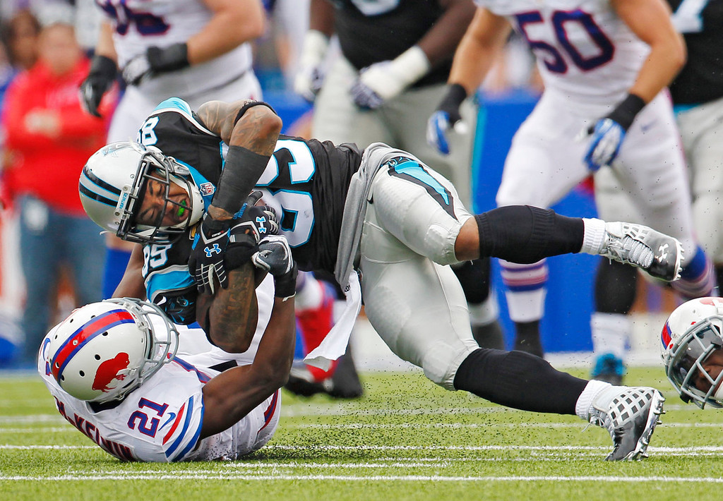 . Buffalo Bills cornerback Leodis McKelvin (21) takes down Carolina Panthers wide receiver Steve Smith in the second quarter of an NFL football game Sunday, Sept. 15, 2013, in Orchard Park, N.Y. (AP Photo/Bill Wippert)