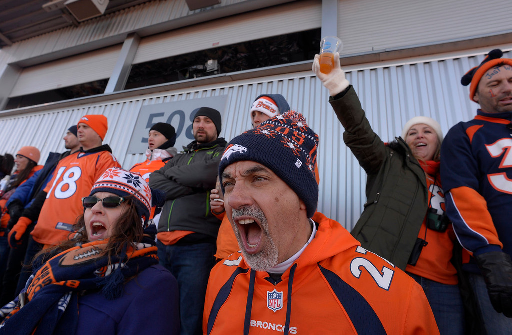 . Rudy Parmelee from Albuquerque, New Mexico cheers for the Broncos during the first quarter. The Denver Broncos take on the San Diego Chargers at Sports Authority Field at Mile High in Denver on January 12, 2014. (Photo by Craig F. Walker/The Denver Post)