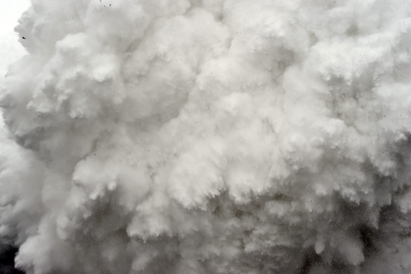 . In this photograph taken on April 25, 2015, a cloud of snow and debris triggered by an earthquake flies towards Everest Base Camp, moments ahead of flattening part of the camp in the Himalayas.   Rescuers in Nepal are searching frantically for survivors of a huge quake on April 25, that killed nearly 2,000, digging through rubble in the devastated capital Kathmandu and airlifting victims of an avalanche at Everest base camp.  ROBERTO SCHMIDT/AFP/Getty Images