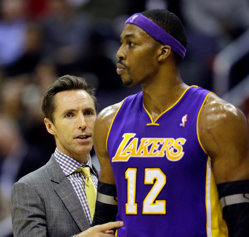 . Los Angeles Lakers guard Steve Nash, left, talks with center Dwight Howard during a timeout in the second half of an NBA basketball game against the Washington Wizards Friday, Dec. 14, 2012 in Washington. The Lakers won 102-96. (AP Photo/Alex Brandon)