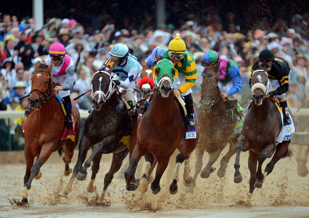 . LOUISVILLE, KY - MAY 04:  Palace Malice ridden by Mike Smith leads the field down around the first turn during the 139th running of the Kentucky Derby at Churchill Downs on May 4, 2013 in Louisville, Kentucky.  (Photo by Michael Heiman/Getty Images)