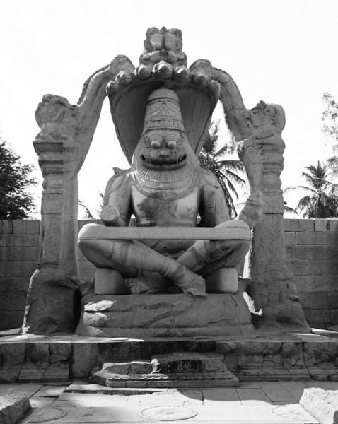 The statue of Laxminarasimha or Ugranarasimha. This is pretty much the signature of Hampi. The band across his knees holds the legs which were broken in the rampage following the fall of Hampi.
