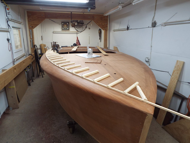 Jigs made to hold the batten in place so the deck seam can be routed.