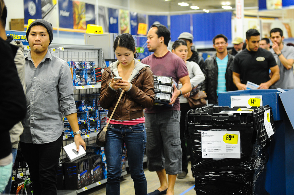 . Shoppers wait in a very long line at Best Buy after the store opened its doors at 6 p.m. for early Black Friday sales on Thanksgiving in San Bernardino on Thursday, Nov. 28, 2013. Many retail stores pushed the boundary the Black Friday tradition this year with offering Black Friday deals on Thanksgiving day. (Photo by Rachel Luna / San Bernardino Sun)