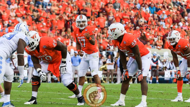 QB Josh Jackson motions to his offense before the snap. (Mark Umansky/TheKeyPlay.com)