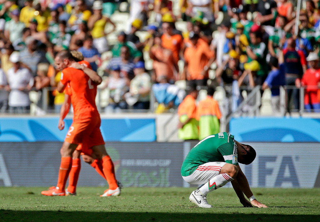 . Mexico\'s Javier Hernandez pauses on the pitch after the Netherlands defeated Mexico 2-1 to advance to the quarterfinals during the World Cup round of 16 soccer match between the Netherlands and Mexico at the Arena Castelao in Fortaleza, Brazil, Sunday, June 29, 2014. (AP Photo/Felipe Dana)