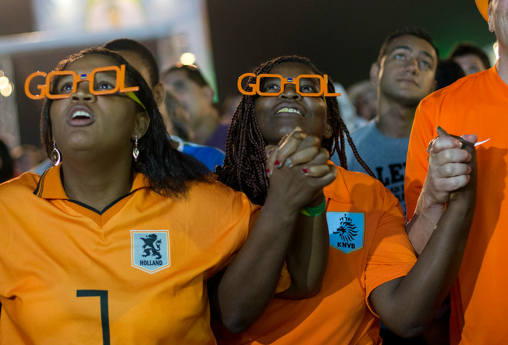 . Soccer fans of the Dutch national soccer team watch the penalty shoot out, during a live broadcast of the soccer World Cup semifinal match between Argentina and Netherlands, inside the FIFA Fan Fest area on Copacabana beach, in Rio de Janeiro, Brazil, Wednesday, July 9, 2014. Argentina made it to the World Cup final with a 4-2 shootout win over the Netherlands after the game finished in a 0-0 stalemate. (AP Photo/Silvia Izquierdo)