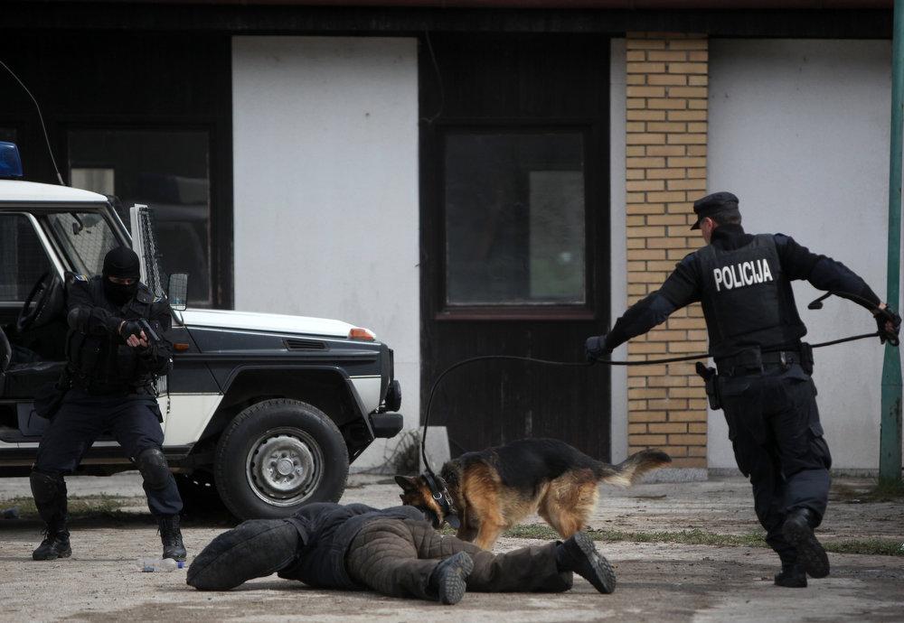 . Members of Special Police Force from the city of Zenica participate during an anti soccer hooligan exercise with people role-playing as demonstrators in Nemila, March 18, 2013. The local police organized a final exercise in preparation against soccer hooliganism for the upcoming World Cup qualifier soccer match between Greece and Bosnia on March 22. According to local media, local police are anticipating violence which may arise among Serbian supporters, who support the Greek team, and Bosnian fans. REUTERS/Dado Ruvic