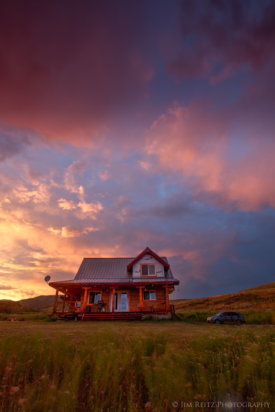 Surreal colors as a thunderstorm clears up just as the sun sets at the cabin, outside Winthrop, WA.
