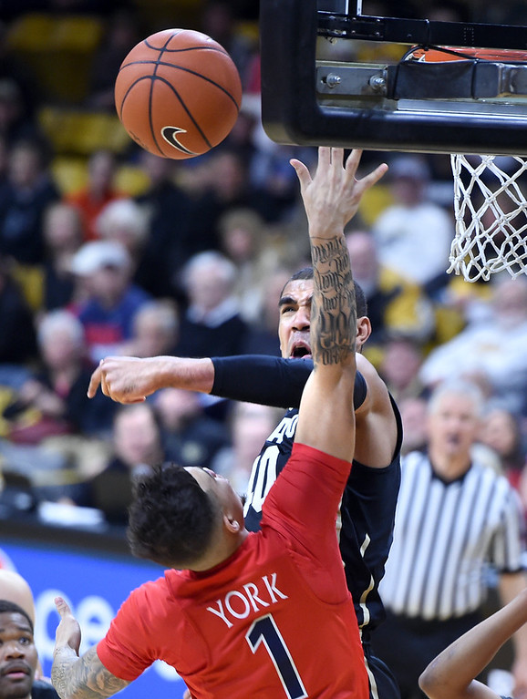. Colorado forward Josh Scott blocks the shot of Arizona\'s Gabe York during the first half of an NCAA college basketball game Wednesday, Feb. 24, 2016, in Boulder, Colo. (AP Photo/Cliff Grassmick)