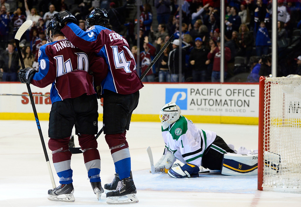. Colorado Avalanche left wing Alex Tanguay (40) and Colorado Avalanche right wing Dennis Everberg (45) celebrate after scoring on Dallas Stars goalie Jhonas Enroth (1) during the third period Saturday, February 14, 2015 at the Pepsi Center in Denver, Colorado. (Photo By Brent Lewis/The Denver Post)