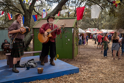 Buskers Perform in the Festival Village