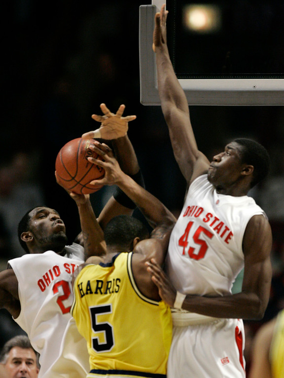 . Ohio State center Greg Oden, left and teammate Othello Hunter put a squeeze on Michigan guard Dion Harris during the first half of the Big Ten conference basketball quarterfinals game in Chicago, Friday, March 9, 2007. (AP Photo/Brian Kersey)