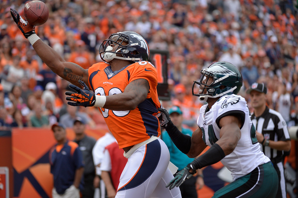 . Denver Broncos wide receiver Demaryius Thomas (88) gets his hand on the ball for a third quarter touchdown over Philadelphia Eagles cornerback Bradley Fletcher (24.)  (Photo by Joe Amon/The Denver Post)