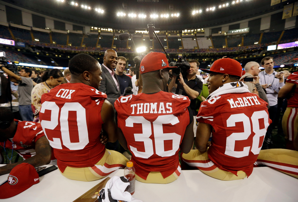 Description of . San Francisco 49ers defensive back Perrish Cox, Michael Thomas and Darcel McBath answer questions during media day for the NFL Super Bowl XLVII football game Tuesday, Jan. 29, 2013, in New Orleans. (AP Photo/Pat Semansky)