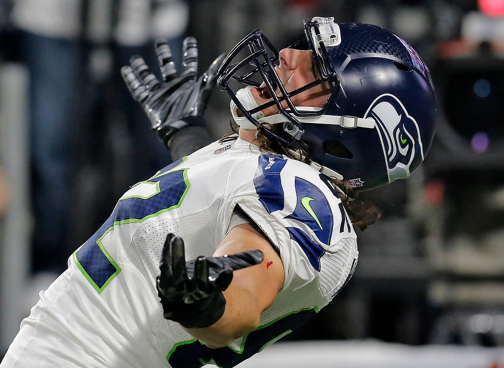 . Seattle Seahawks tight end Luke Willson celebreats his touchdown during the first half of an NFL football game against the Arizona Cardinals, Sunday, Dec. 21, 2014, in Glendale, Ariz. (AP Photo/Rick Scuteri)