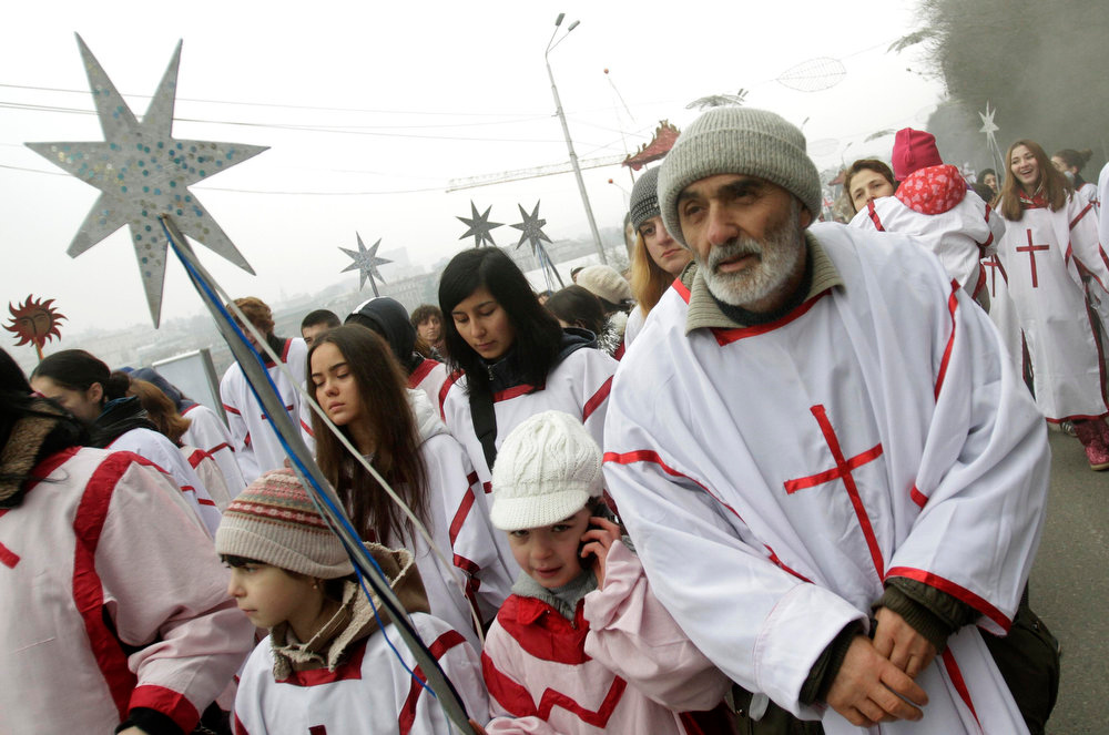 ". Participants march on the street during ""Alilo\"", a religious procession, to celebrate the Orthodox Christmas in Tbilisi January 7, 2013. Believers celebrate Christmas on January 7, according to the Julian calendar used by the country\'s Orthodox church. REUTERS/David Mdzinarishvili"